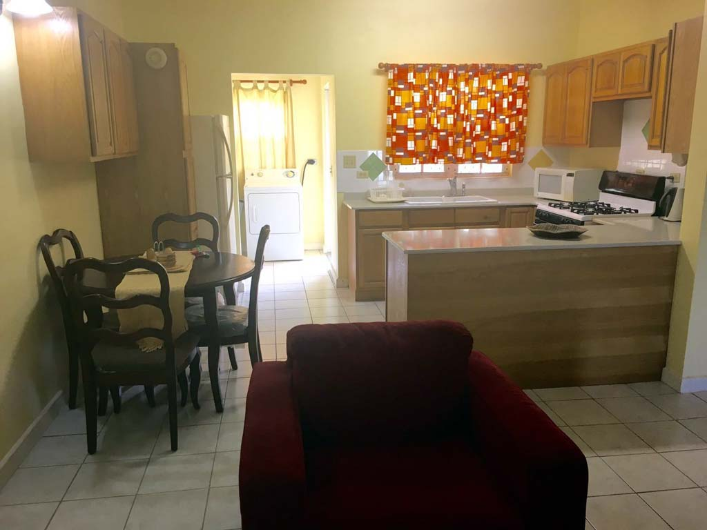 Alpha Suites dining area and kitchen