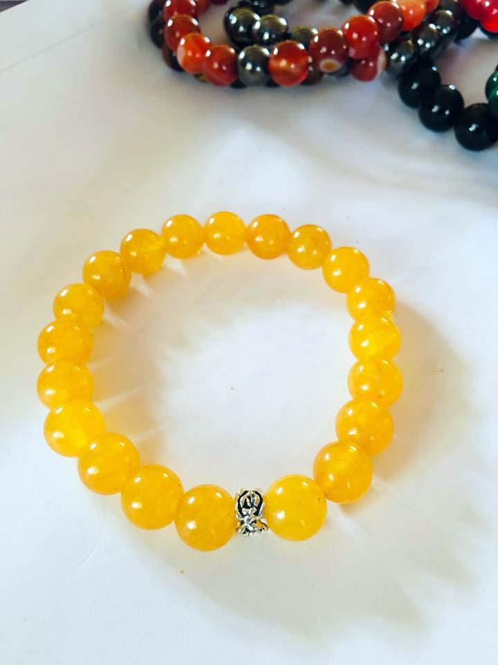 Althea's yellow beaded bracelet