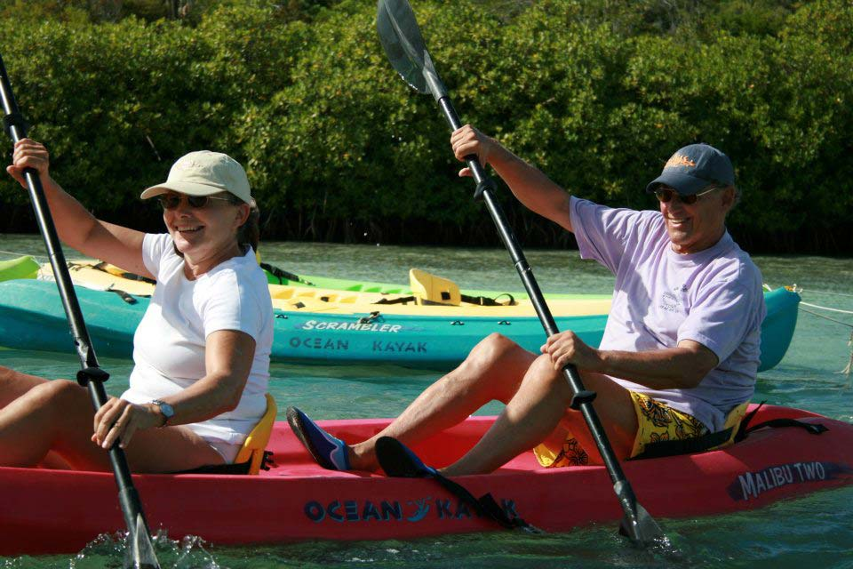 Antigua Paddles couple enjoying the ride