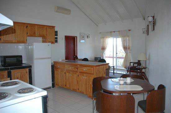 Royal Cove Hotel kitchen and dining area