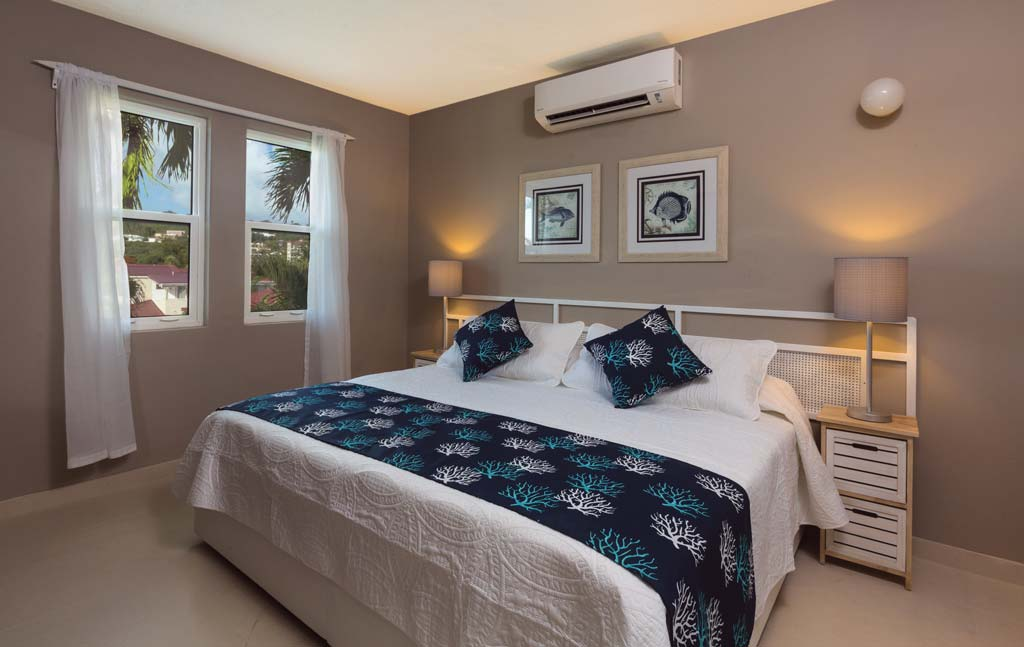Siboney Beach Club garden view suite living bedroom