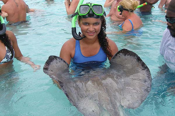 Stingray City girl with ray
