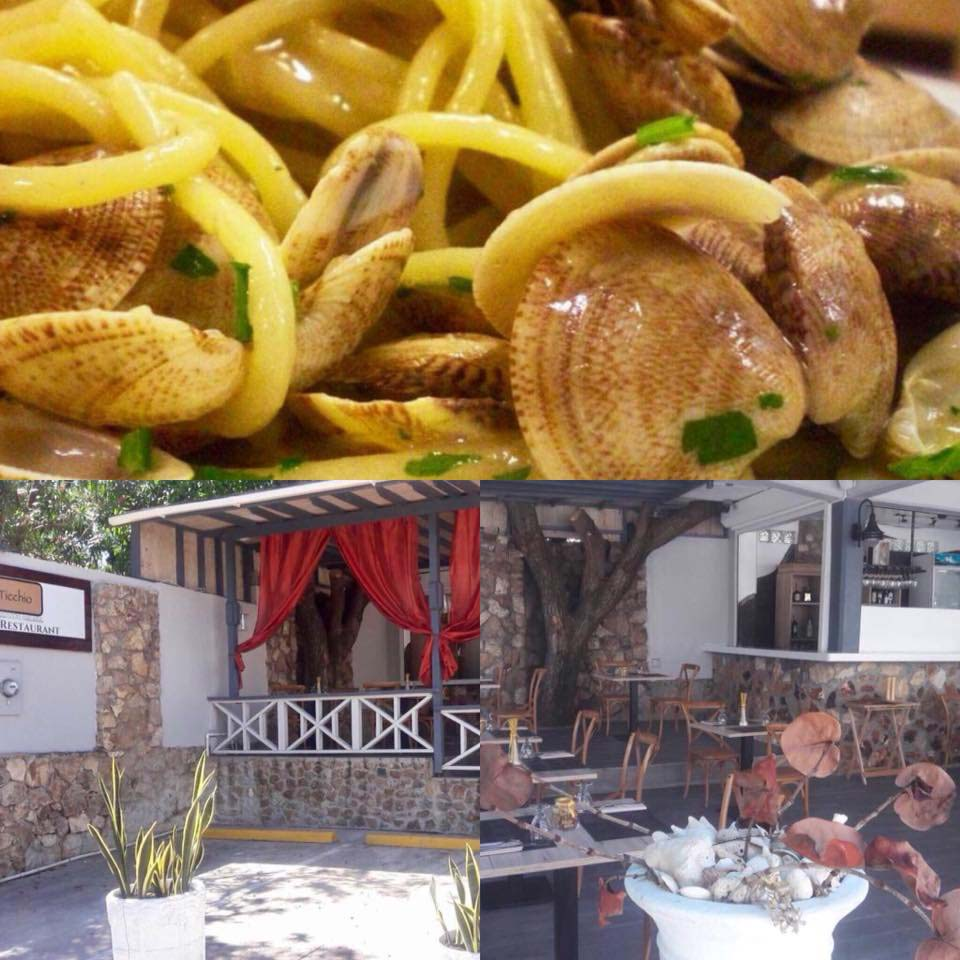 Ticchio spaghetti with clams and outdoor seating