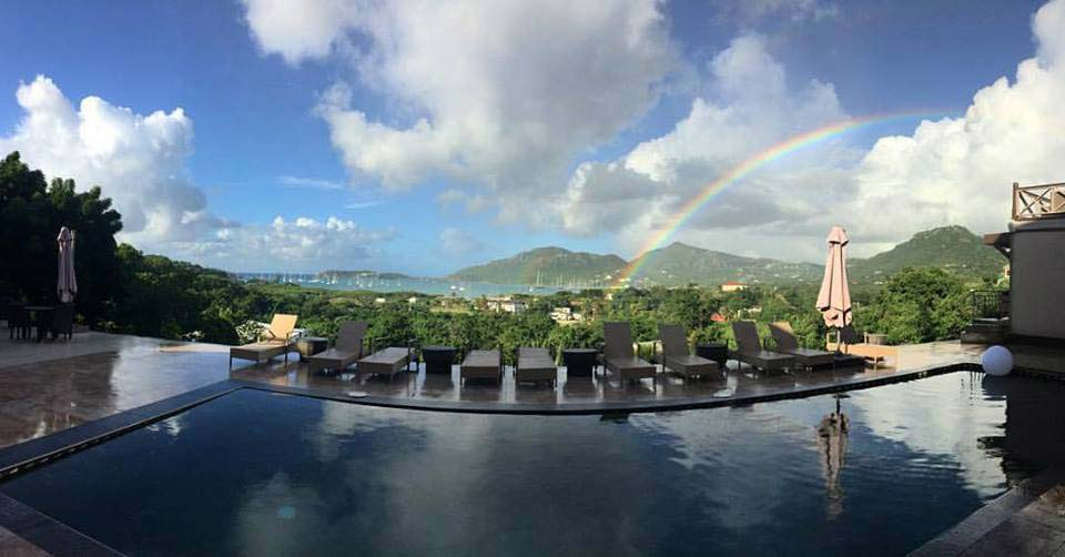 Vine Cottages panoramic pool with rainbow